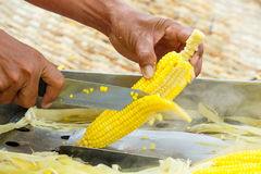 Slicing steamed corn Royalty Free Stock Images