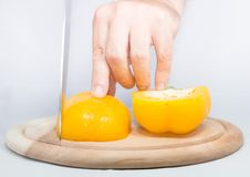 Slicing a sweet yellow pepper Stock Image