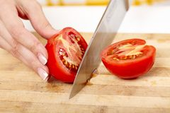 Free Slicing The Tomato On A Wooden Board Stock Images - 36139884