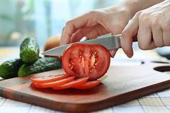 Slicing tomato Stock Images