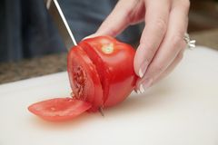 Slicing a tomato Royalty Free Stock Images