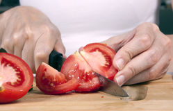 Slicing Tomatoes  Stock Image