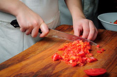 Slicing tomatoes Stock Images