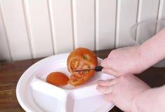 Slicing Tomatoes Royalty Free Stock Image