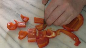 Slicing up a Red Pepper stock footage