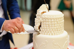 Slicing the wedding cake Stock Photo