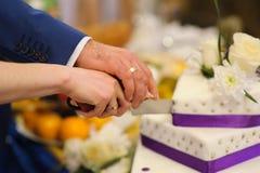 Slicing the wedding cake Stock Images