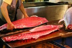 Slicing yellow-fin Tuna in Tsukiji fish market Royalty Free Stock Photography