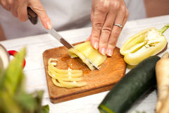 Slicing of yellow pepper Stock Photography