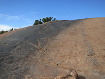 Slick Rock. Tire marks on an off-road trail near Moab, Utah, USA, lead up a steep slick rock Royalty Free Stock Photos