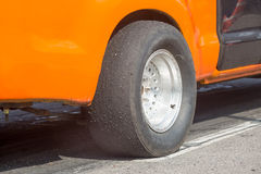 Slick tyre for drag racing car Stock Images