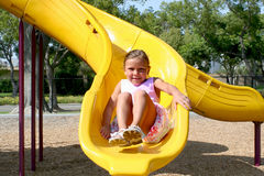 Slide. A young girl enjoying summertime at the part Royalty Free Stock Image