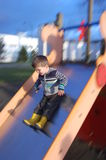 On the slide. Happy 3 yrs old boy - On the slide Royalty Free Stock Photo