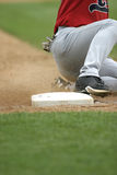 Slide. Runner sliding into 3rd base royalty free stock photo