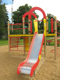 The slide. The children playground with different attractions Royalty Free Stock Image