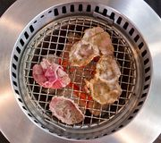 Slide beef on the grill in japanese restaurant. Royalty Free Stock Photo