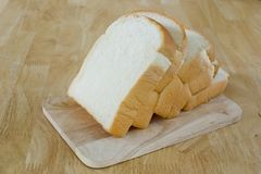 Slide bread on wooden cutting board Stock Image