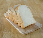 Slide bread on wooden cutting board Stock Photo