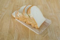 Slide bread on wooden cutting board Stock Images