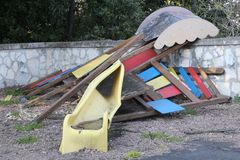 Slide broken and abandoned in a deserted playground after the di Stock Photos