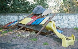 Slide broken and abandoned in a deserted playground Stock Photography