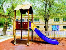 Slide for children in the park. Playground in nature. Place to spend summer and spring evenings stock photography