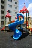 Slide on children`s playground. Slide at outdoor children`s playground set Stock Photography