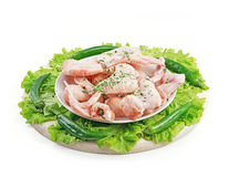 Slide chilled chicken wings on a plate and wooden tray. Studio isolation Royalty Free Stock Image