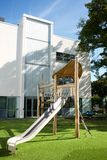 Slide and climbing frame in a modern school playground stock photo