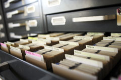 Slide collection. Looking through large slide catalog archive library Stock Photo