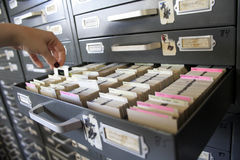 Slide collection. Looking through large slide catalog archive library Stock Photography