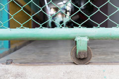 Slide door with wheel bearing. Or Caster steel wheels fence royalty free stock image