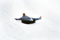 Slide down mountain. Young people have fun in the winter Stock Image