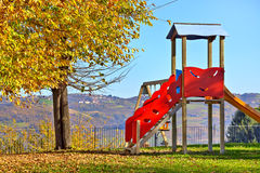 Slide on empty playground. Stock Photos