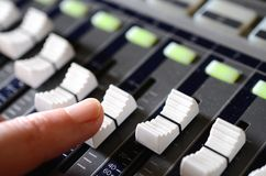 Slide the fader, mix the music Stock Image
