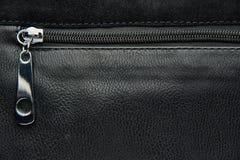 Slide fastener on black leather bag. Copy space stock image
