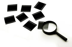 Slide film and magnifier glass Stock Photos