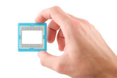 Slide frame. In hand, isolated white Stock Images