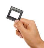 Slide frame in hand stock photo