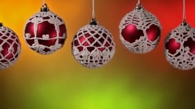 Slide in front of beautiful christmas baubles hanging stock footage