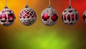 Slide in front of beautiful christmas baubles hanging stock video
