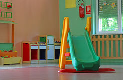 Slide and games inside a school for young children Royalty Free Stock Image