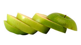 Slide green apple to step slice Royalty Free Stock Photos