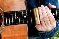 Slide Guitar. With brass slide royalty free stock photos