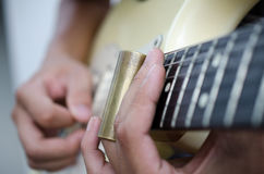 Slide guitar. Blues slide guitar,Electric guitar player performing song with slider Stock Image