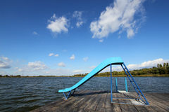 Slide on the lake dock Royalty Free Stock Photo