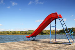 Slide on the lake dock Royalty Free Stock Photos