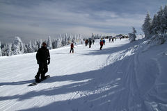 Slide On Mount Tremblant. Skiers on the heights of Mont Tremblant, Quebec, Canada Royalty Free Stock Images