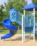 Slide Play Area. A kid's blue slide combination play equipment in park royalty free stock photo
