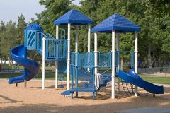 Slide Play Area. A blue slide combination play equipment in park stock image